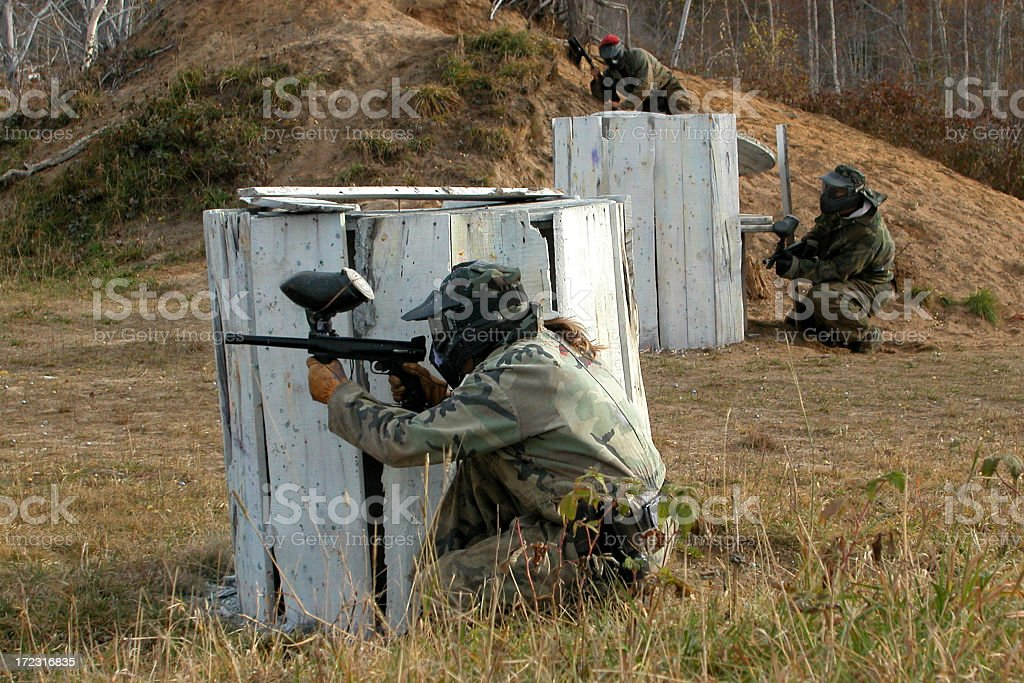 Paintball Player Woman in Action stock photo