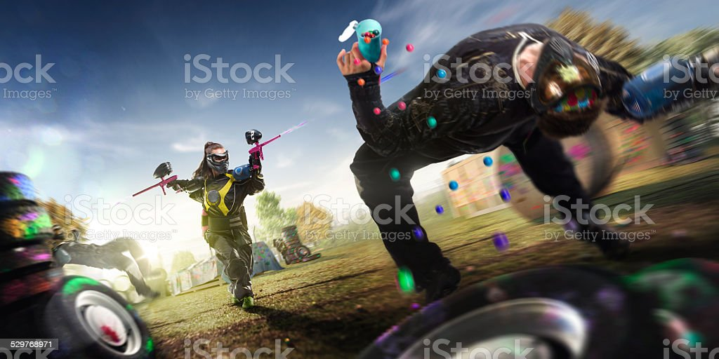 Paintball players are playing the game stock photo
