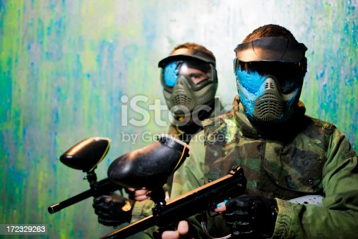 Close up of paintball players with paint on  protective mask