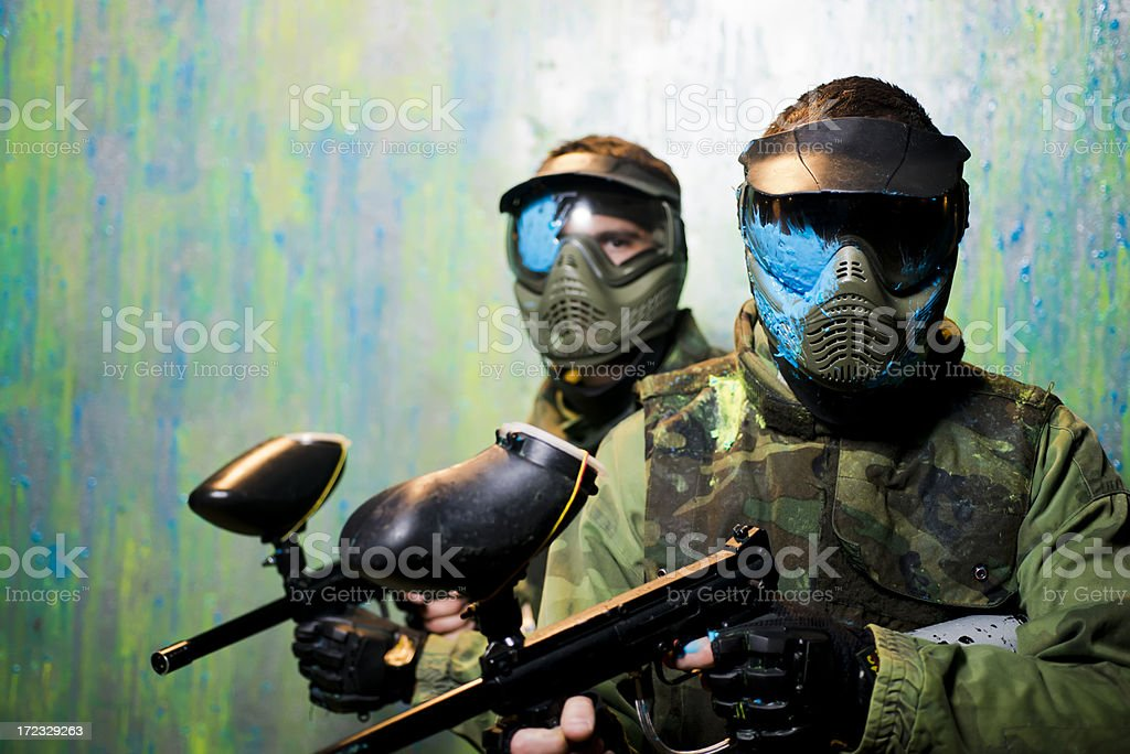 Paintball players with protective masks stock photo