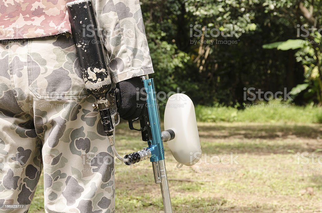paintball sport player in protective uniform and gun royalty-free stock photo