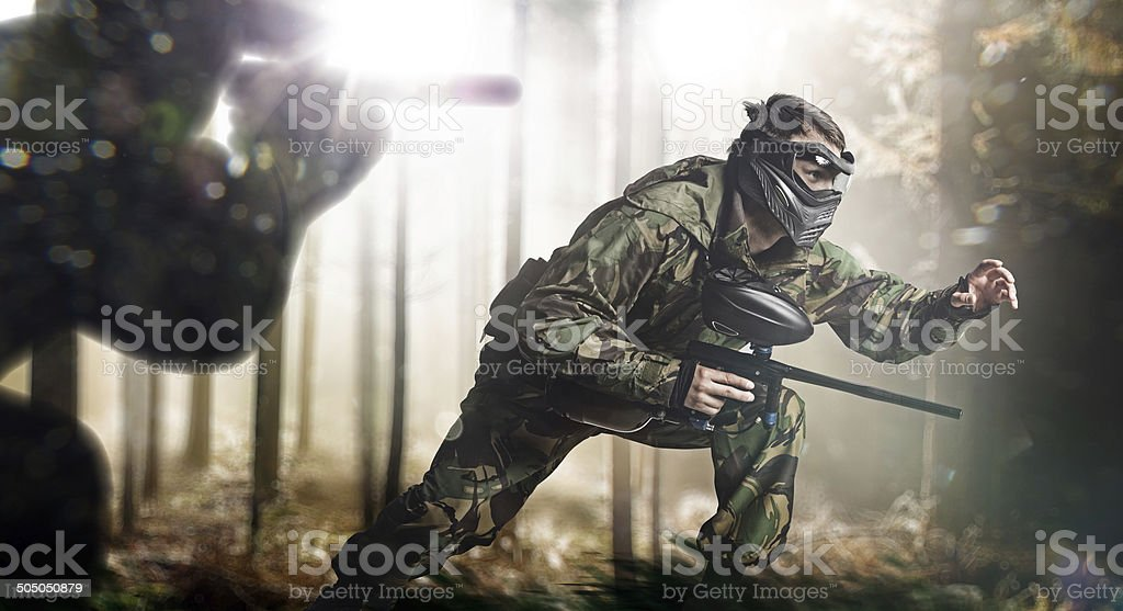 Paintball team in action stock photo