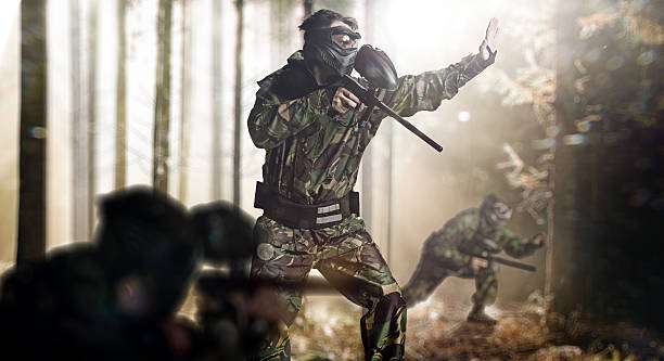 Paintball team in action – Foto