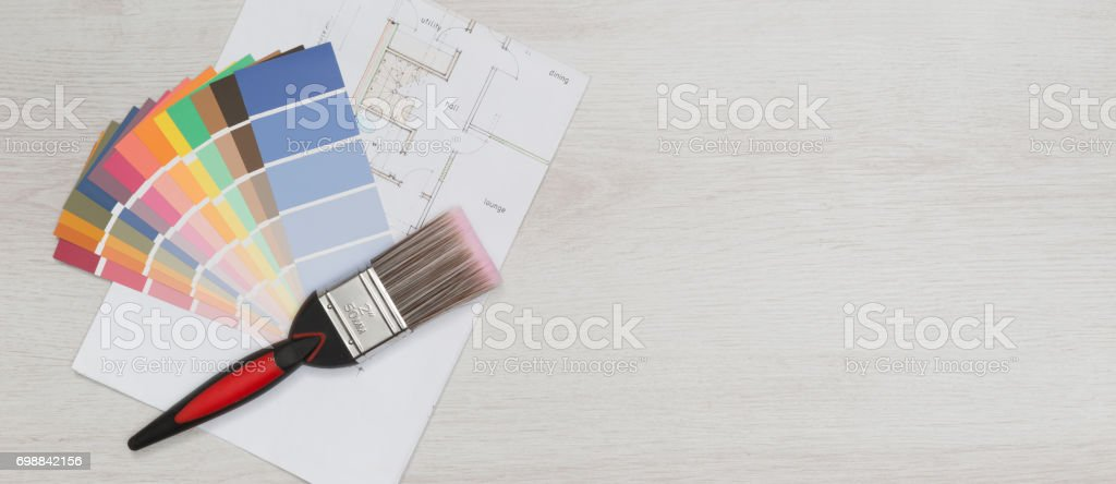 Paintbrush and paint swatches on blueprint with copy space stock paintbrush and paint swatches on blueprint with copy space royalty free stock photo malvernweather Image collections