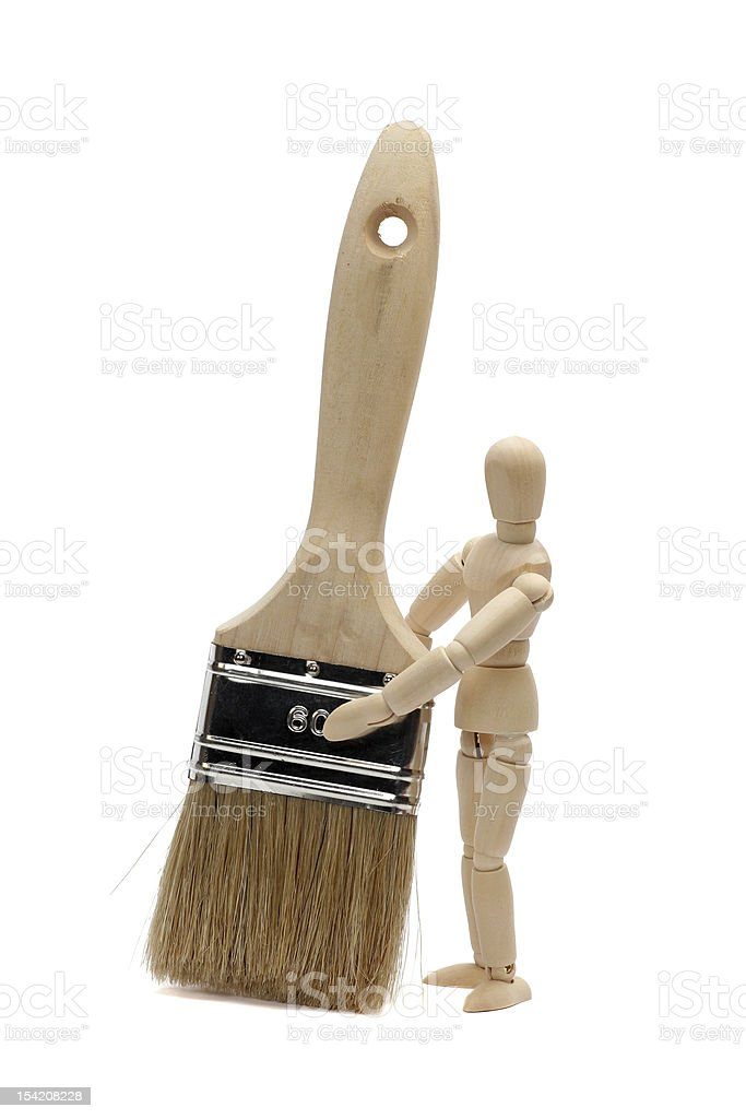 paintbrush and wooden doll royalty-free stock photo