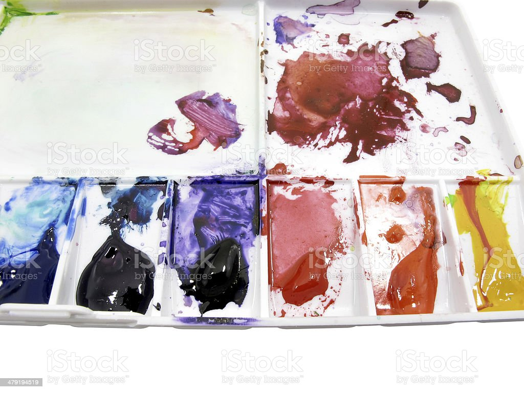 Paintbrush on art palette with blobs stock photo