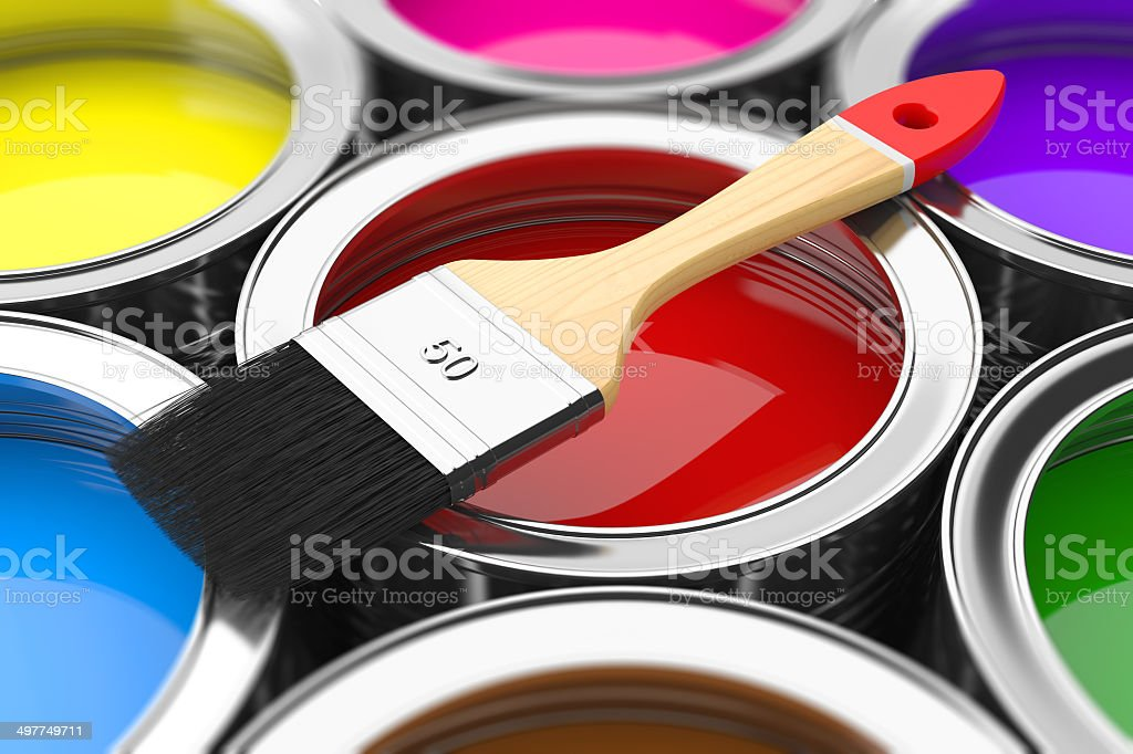 Paintbrush on cans with color prints stock photo