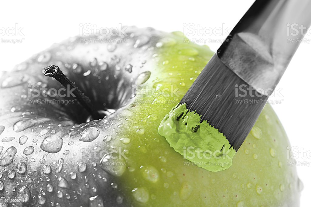 Paintbrush painting a grey apple green royalty-free stock photo