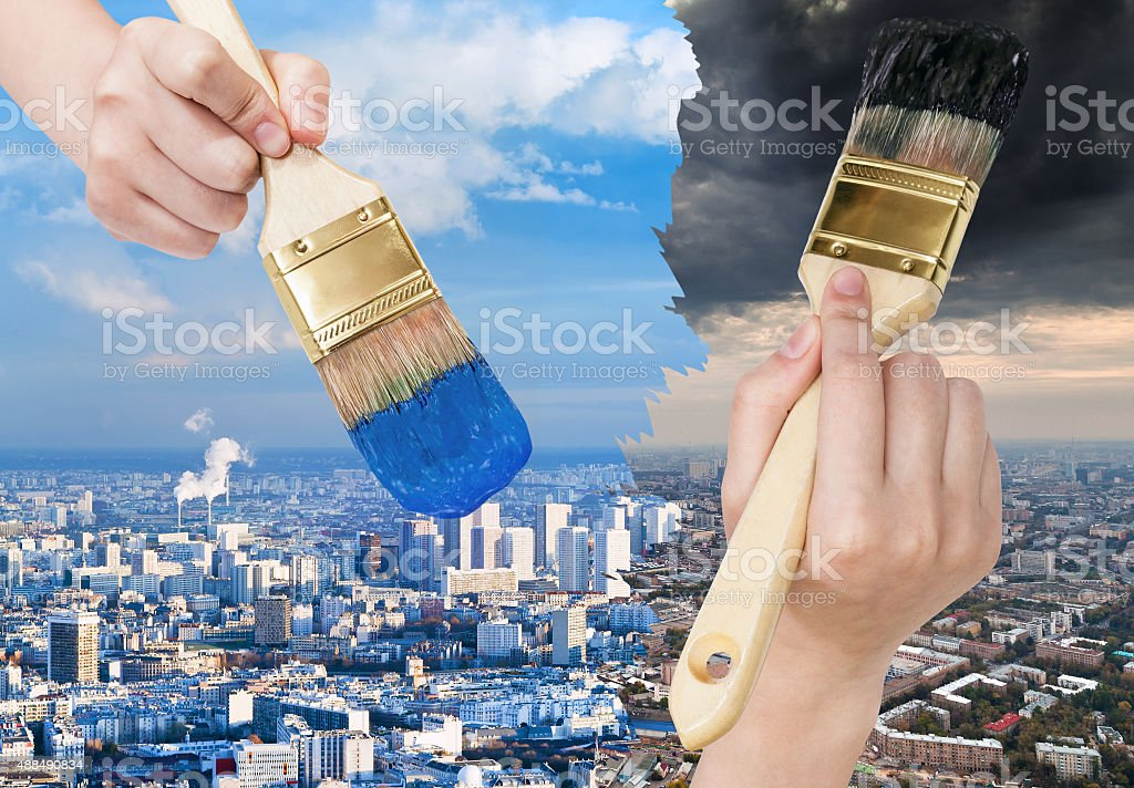 paintbrush paints blue clean and dark dirty city stock photo