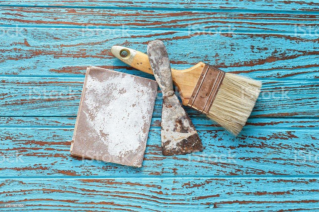 paintbrush  trowel sandpaper  still life wood teak antique stock photo