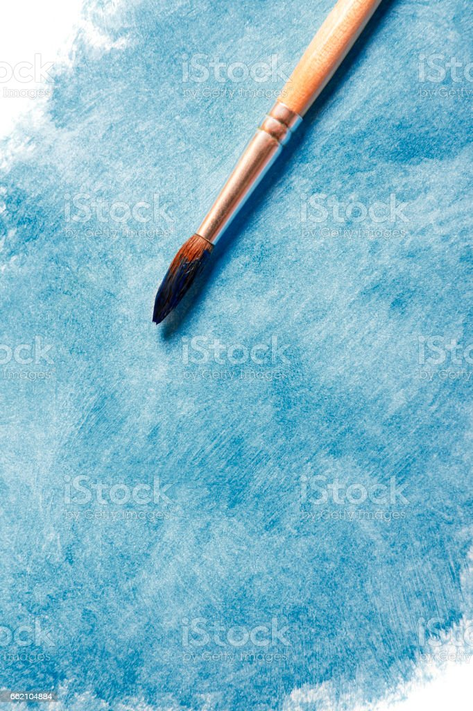 Paintbrush with blue paint royalty-free stock photo
