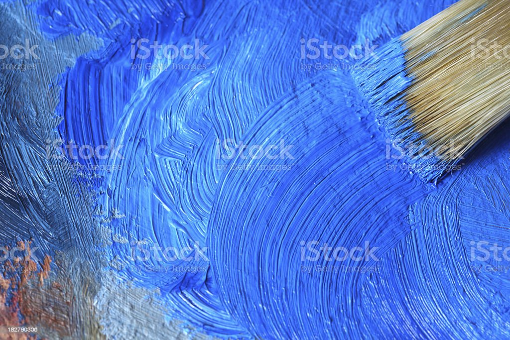 Paintbrush with Cobalt blue oil paint on a classical palette stock photo