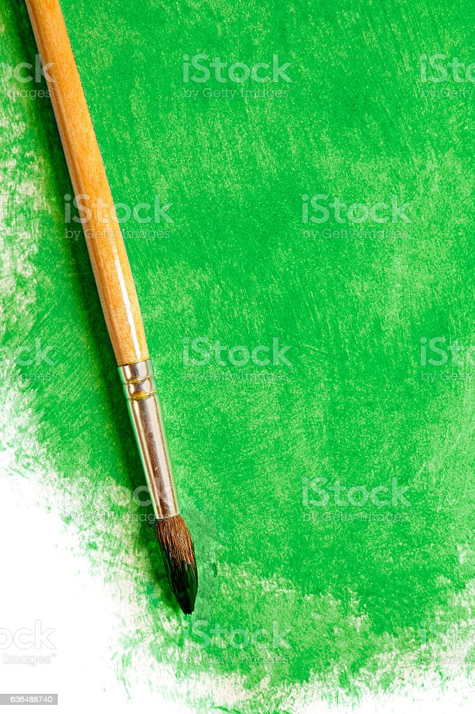 Paintbrush with green paint (on white) stock photo