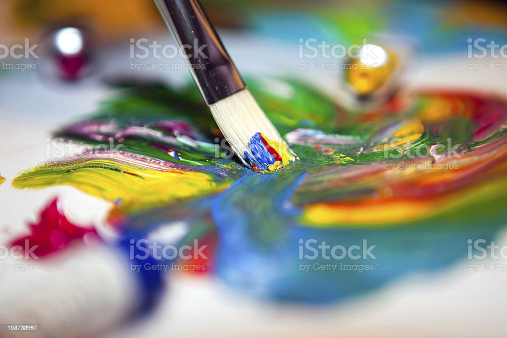 Paintbrush with mixed acrylic paint on paper royalty-free stock photo