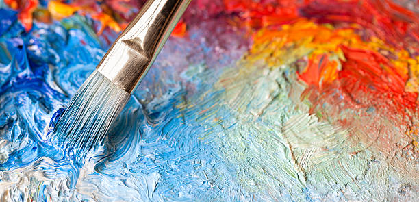 Paintbrush with oil paint on a classical palette stock photo