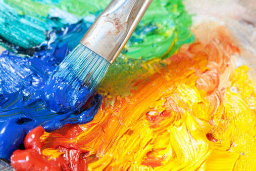 istock Paintbrush with oil paint on a classical palette 185001492