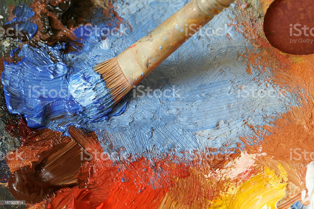Paintbrush with oil paint on a classical palette - XL stock photo