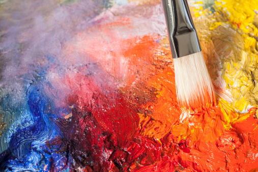 istock Paintbrush with red oil paint on a classical palette 185076956