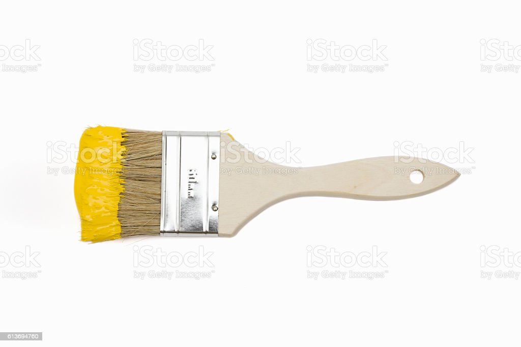 Paintbrush with yellow paint Paintbrush with yellow paint isolated on white Abstract Stock Photo