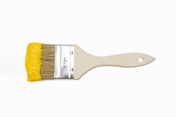 Paintbrush with yellow paint – Foto