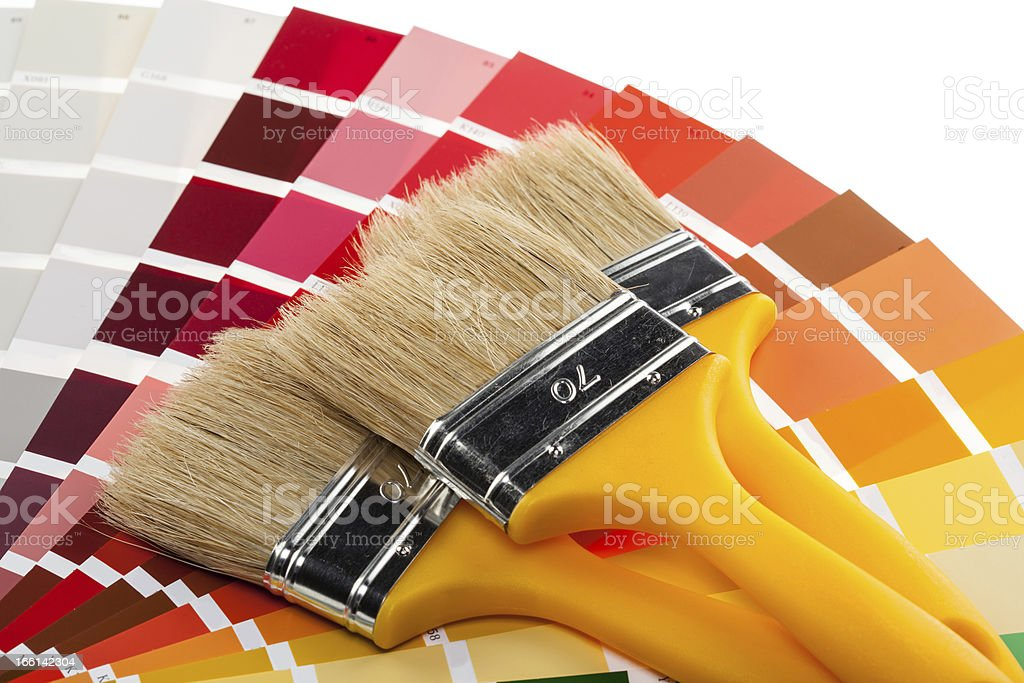 Paintbrushes and color samples royalty-free stock photo