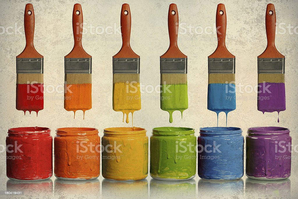 Paintbrushes Dripping into Paint Containers royalty-free stock photo