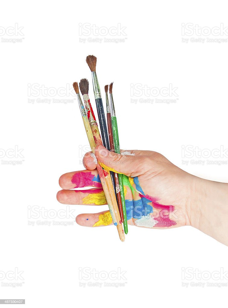 Paintbrushes in hand stock photo