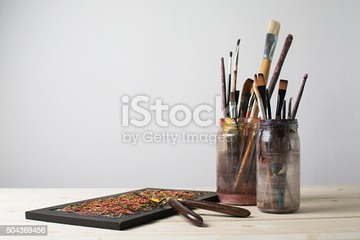 istock Paintbrushes on a table 504369456