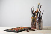 Paintbrushes on a table with palette