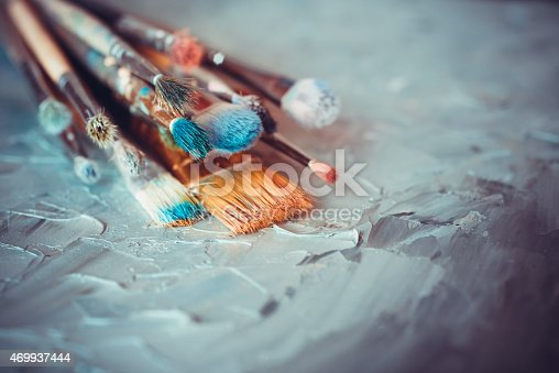 istock Paintbrushes on artist canvas covered  with oil paints 469937444