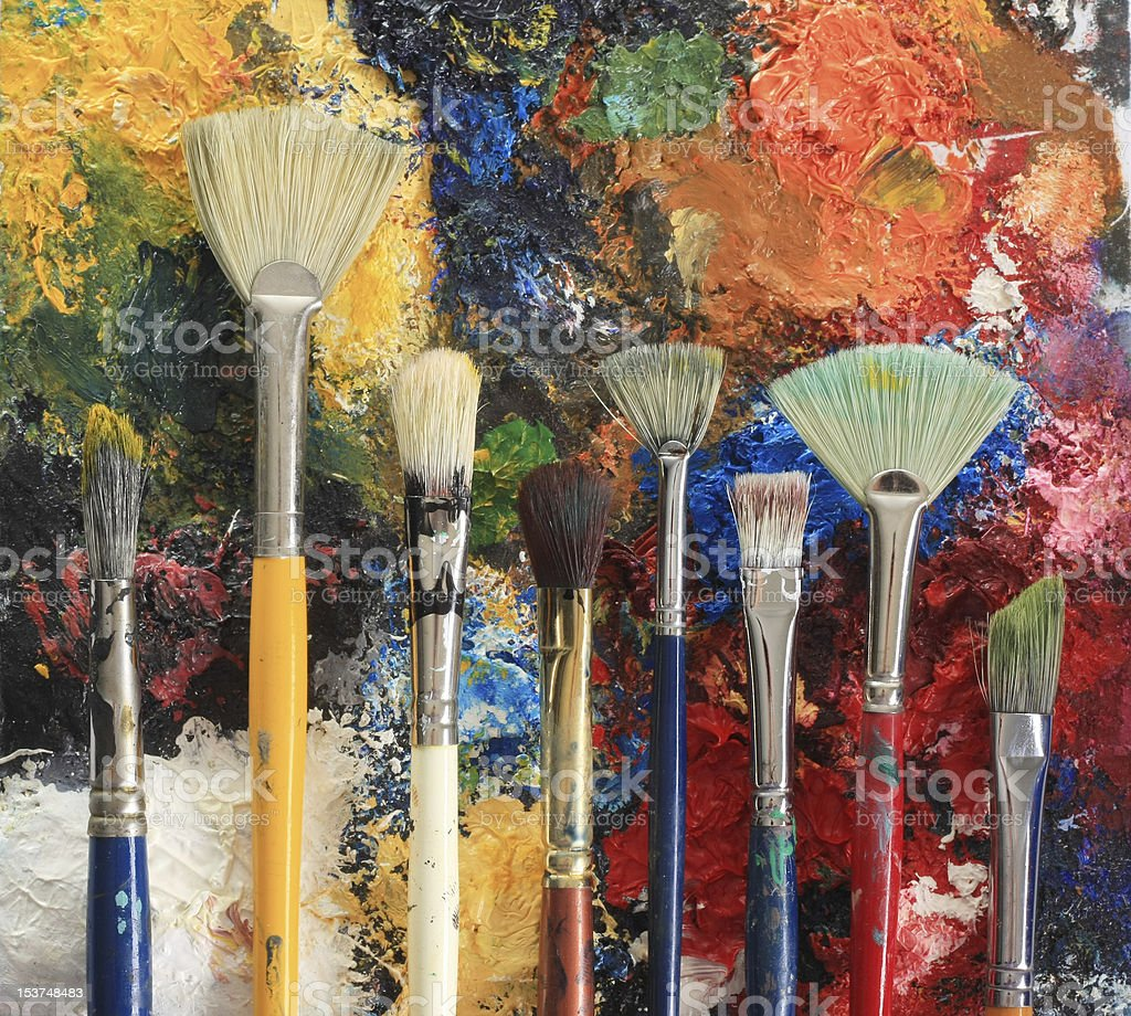 Paintbrushes on oil paint royalty-free stock photo