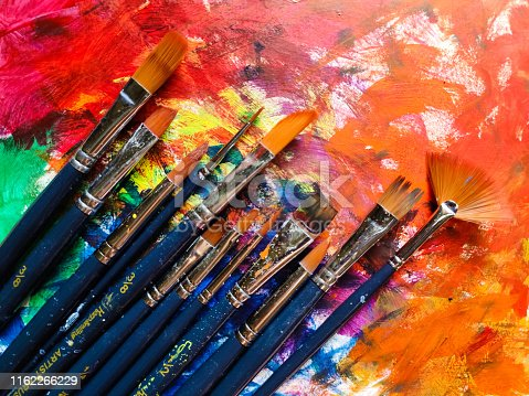 istock Paintbrushes with color on paper 1162266229