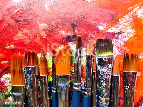 istock Paintbrushes with color on paper 1162266512