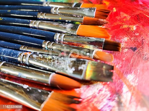 istock Paintbrushes with color on paper 1162335656