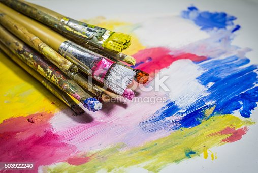 istock Paintbrushes with color on paper 503922240