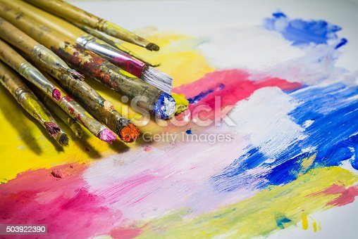 istock Paintbrushes with color on paper 503922390