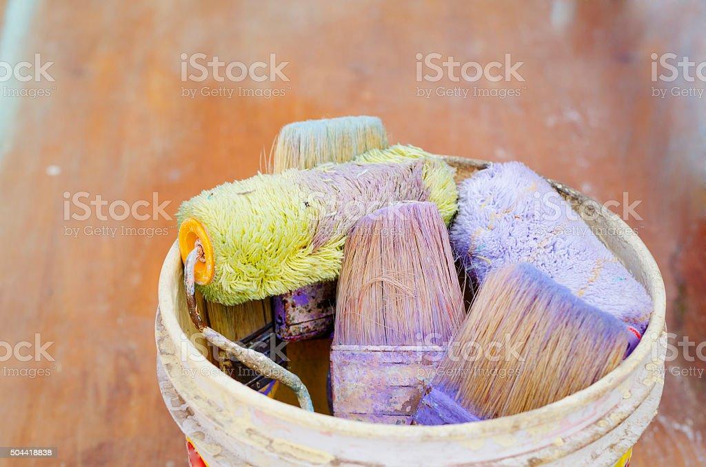 Paintbucket with brushes stock photo