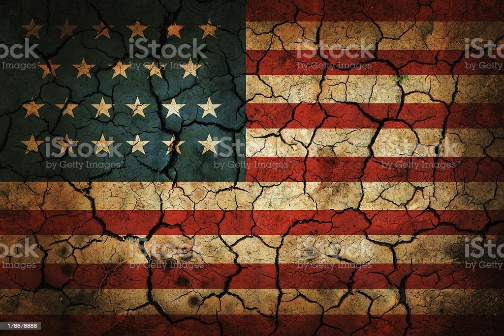 Painted American flag on cracked earth stock photo