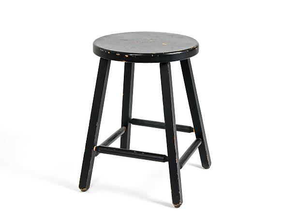 Painted black wooden stool stock photo
