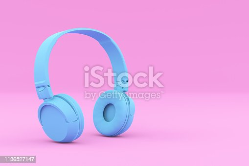 istock Painted Blue Headphones on Pink Background 1136527147