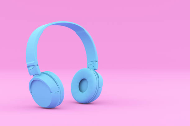 Painted Blue Headphones on Pink Background Modern Painted Blue Headphones on Pink Background. Creative Design in Minimal Style. Trendy duotone effect. 3D render Illustration. headphones stock pictures, royalty-free photos & images