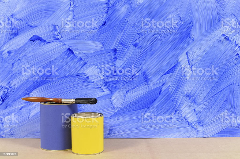 Painted blue wall with paint tins royalty-free stock photo