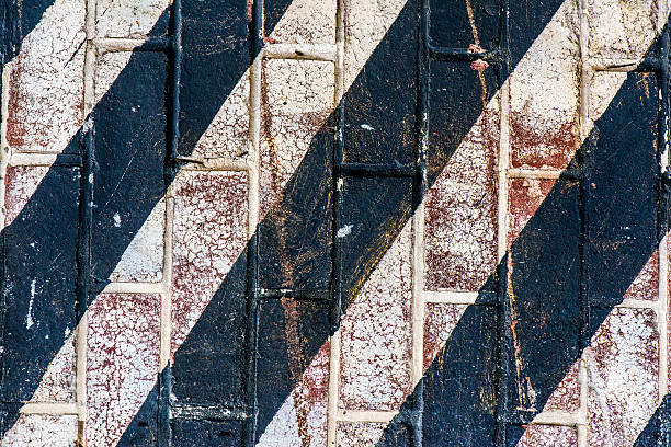 Painted Brick Wall With Diagonal Black Stripes stock photo