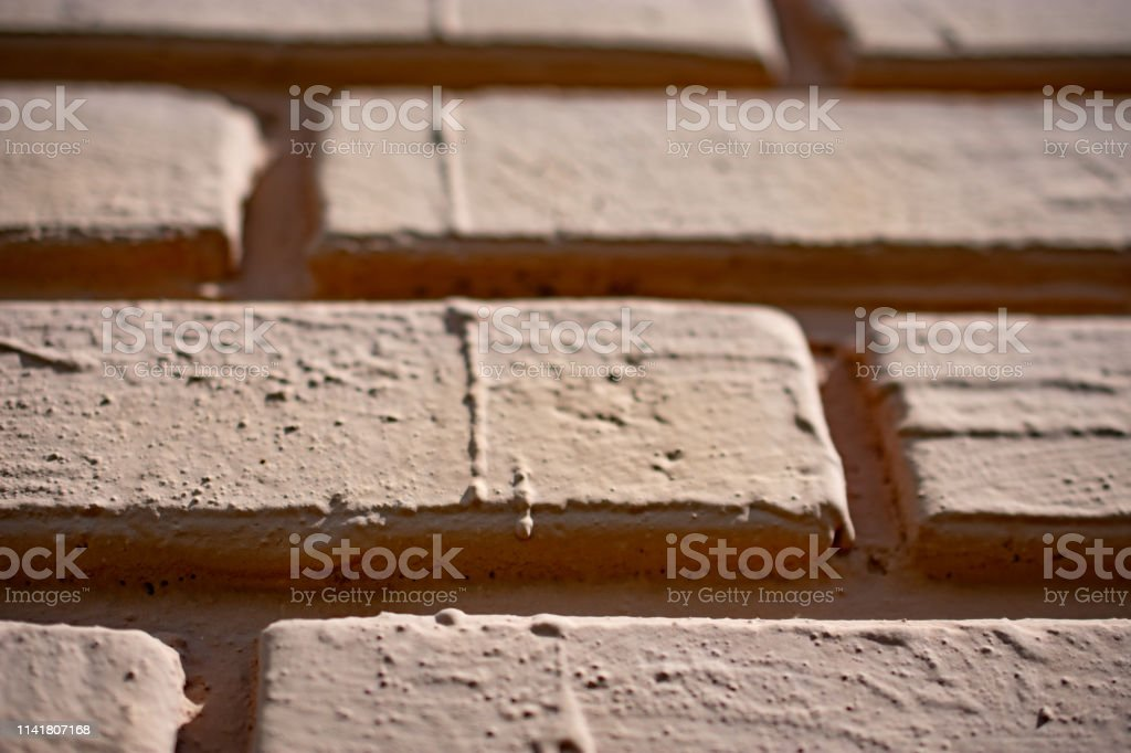 painted brick with deep grout close up stock photo