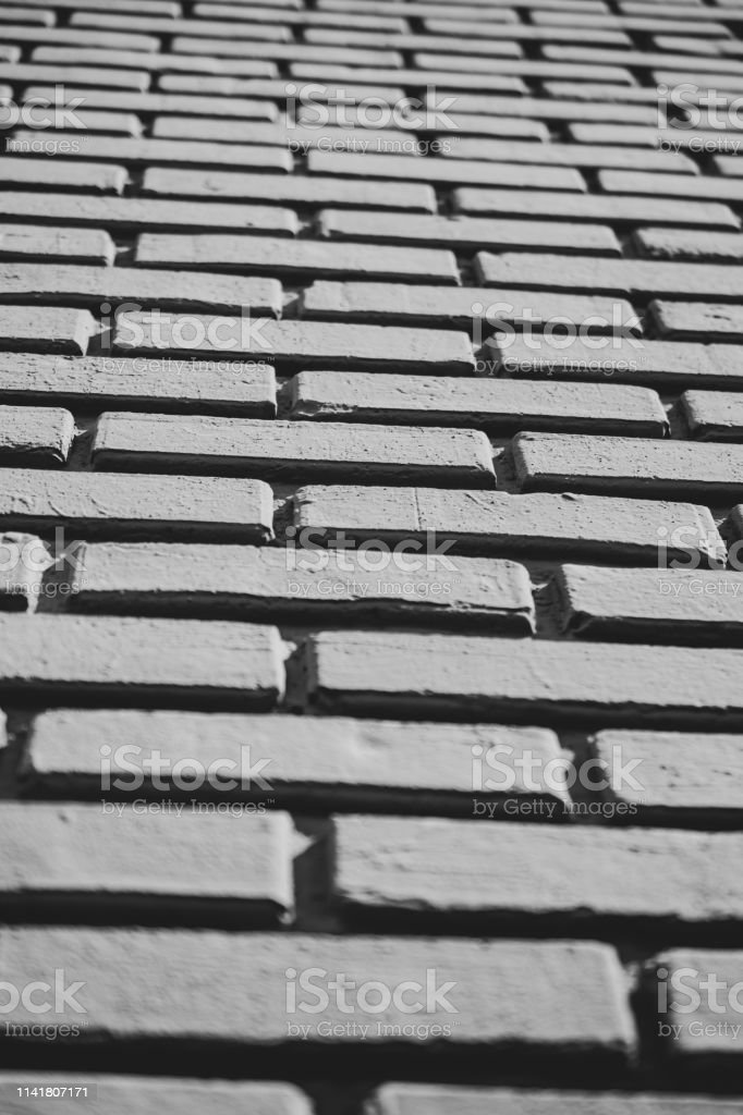 painted brick with deep grout monochrome stock photo