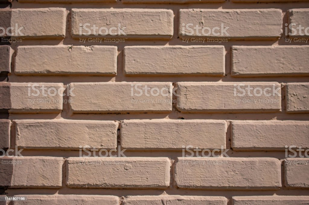 painted brick with deep grout stock photo