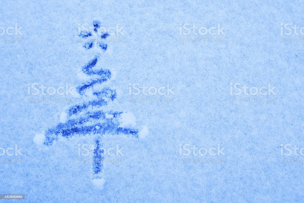 Painted christmas tree on snow background royalty-free stock photo