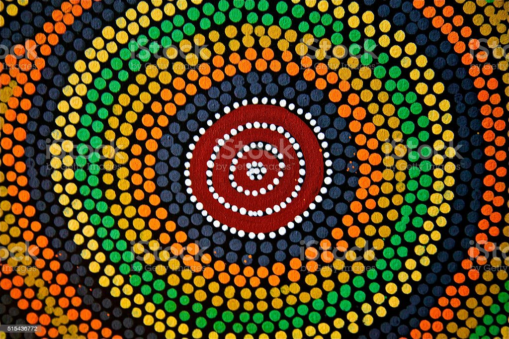 Painted color dot mandala circle Asian African ethnic art craft stock photo