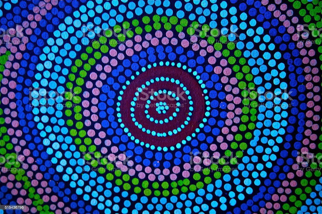 Painted color dot mandala circle Asian African ethnic art craft stock photo