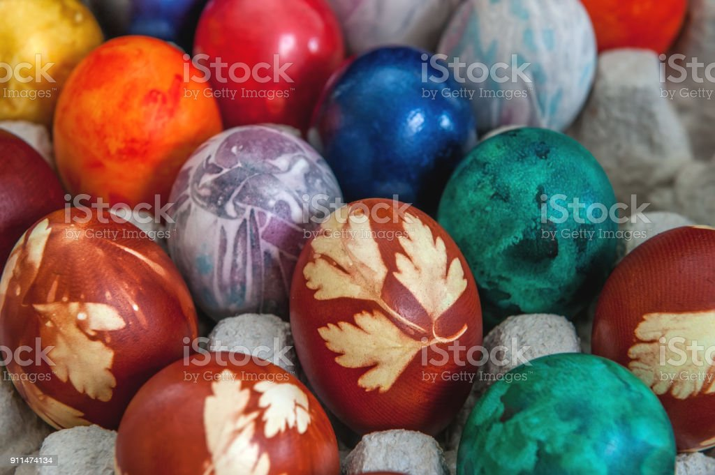 Painted colorful Easter eggs are in the cells in the box. Background stock photo